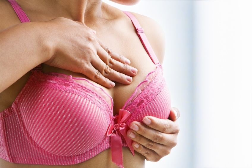 Woman examining her breasts