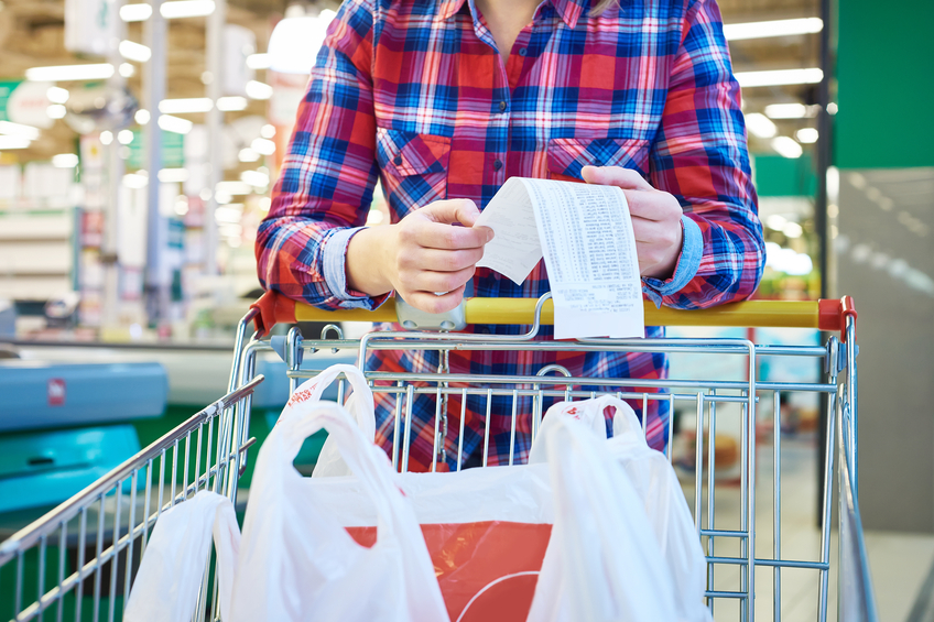 woman checking list in a store