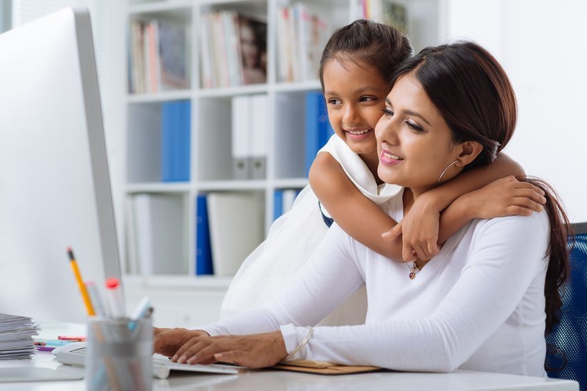 Mother with child in front of computer
