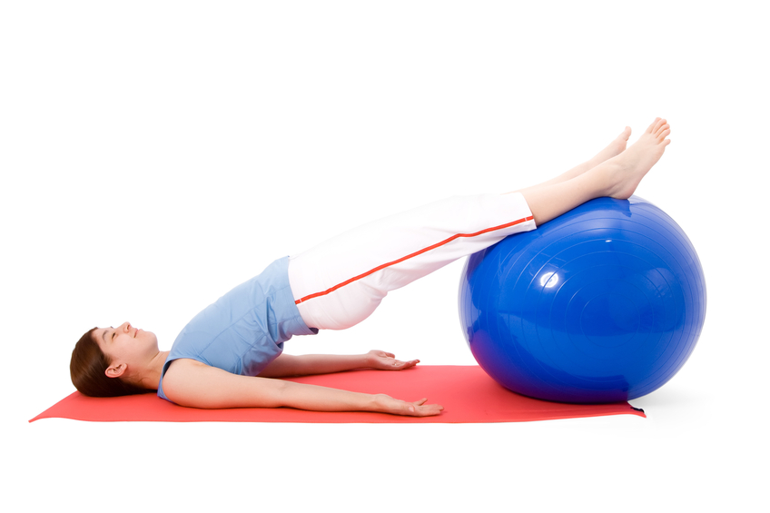 woman performing exercises with fitness ball