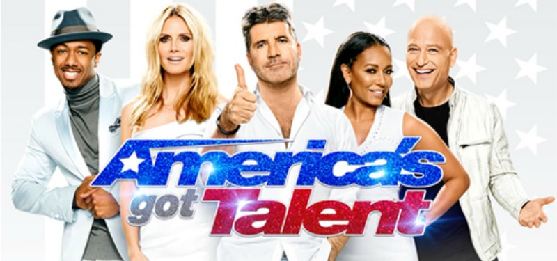 America's got talent judges pose in a promo poster against an American flag background