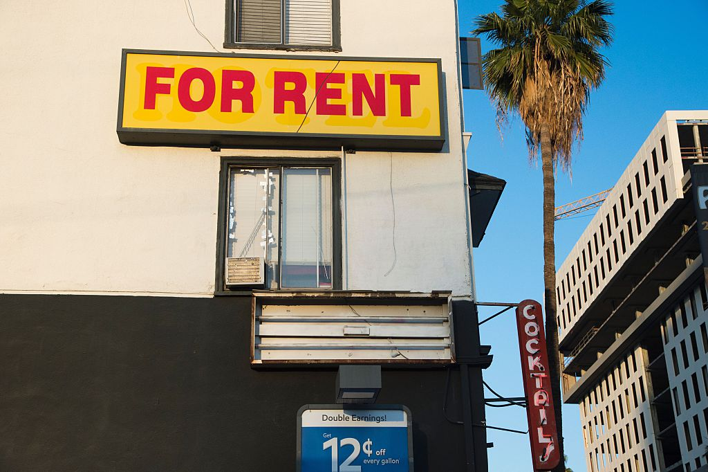 "a ""for rent"" sign on an apartment"