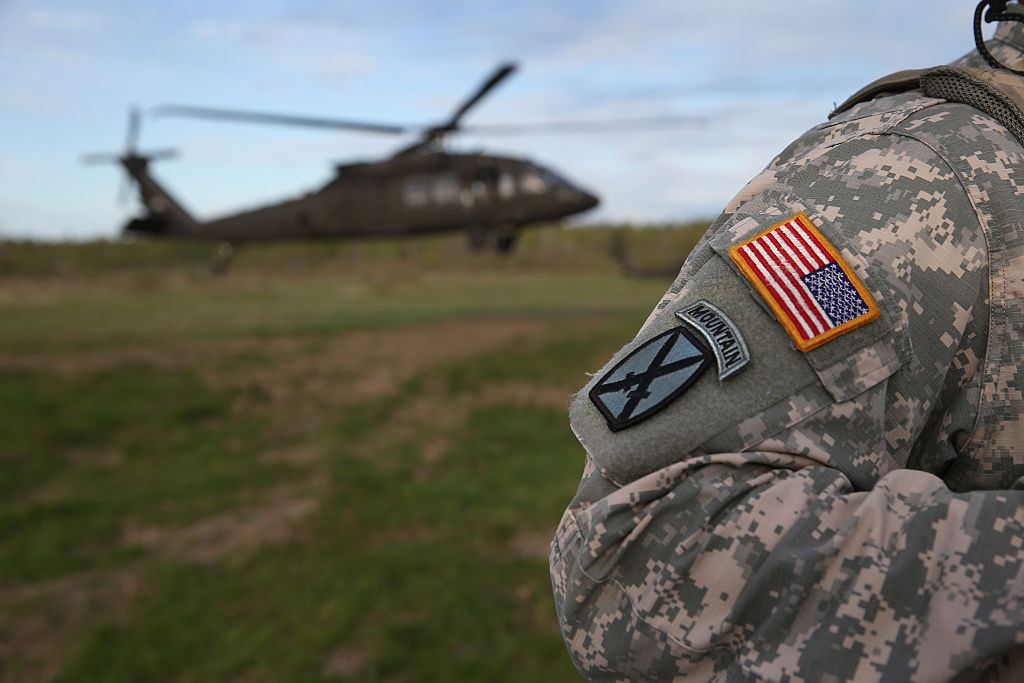 u.s. army soldier and helicopter