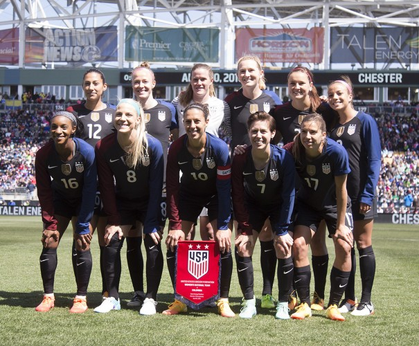 U.S. women's soccer team posing for photos