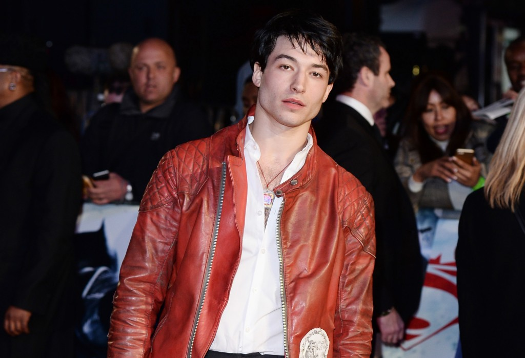 Ezra Miller poses for cameras at the Batman v. Superman: Dawn of Justice premiere