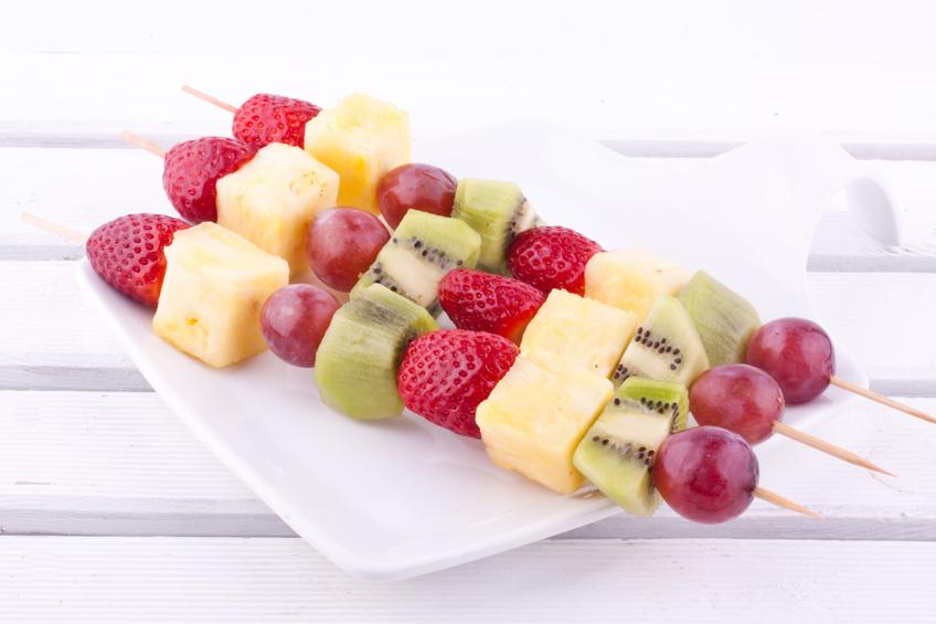 three fruit skewer in white plate