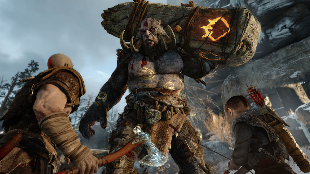 Kratos and his son confront a giant in God of War for PS4.