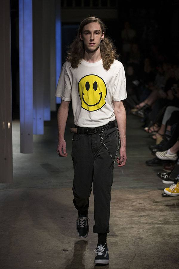 model walking the runway in a graphic t-shirt