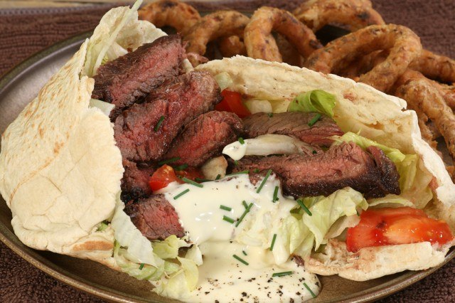 close up of grilled steak in pitta bread