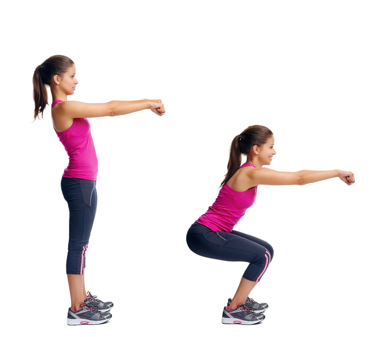 A woman performing a basic squat