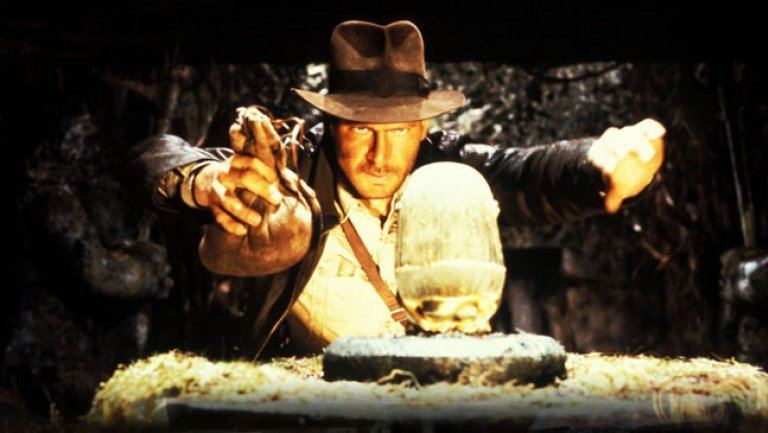 Indiana Jones is getting ready to make a switch in a cave.
