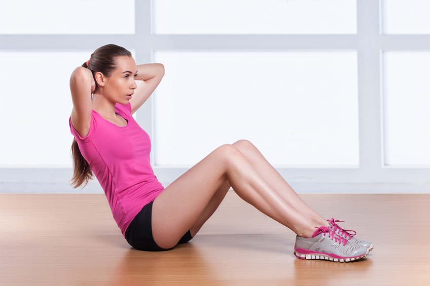 A woman performing a home exercise workout routine