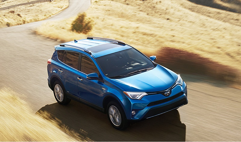 Overhead shot of Toyota RAV4 Hybrid on sunny day in the country
