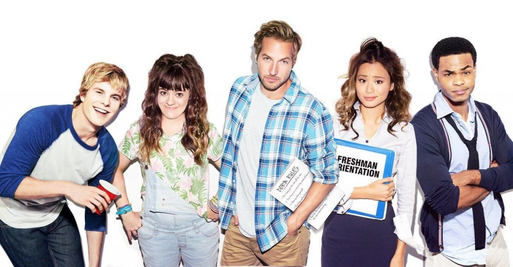 The cast of Resident Advisors poses while holding binders and notebooks