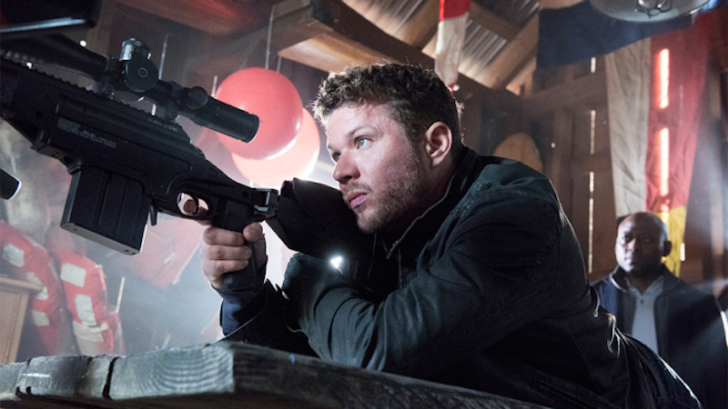 Ryan Phillippe holds up a gun in a scene from Shooter