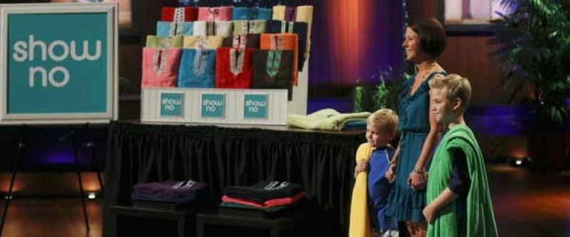 Shelly Ehler pitching shark tank with two kids.