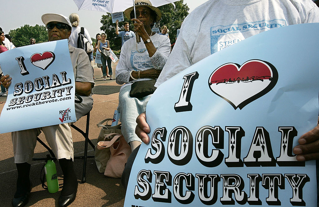 People attend a rally celebrate social security