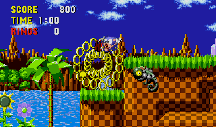 Sonic getting hit and losing his rings.