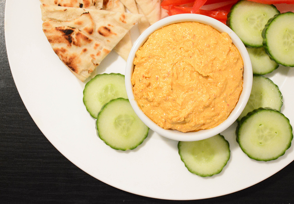 overhead close-up of spicy feta dip with cucumbers