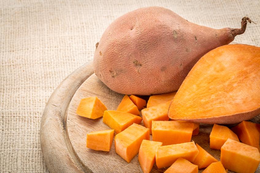 sweet potato diced on wooden board