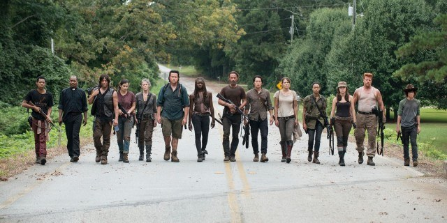 Rick's group presents a united front on their way into Alexandria in a scene from the fifth season of <em>The Walking Dead</em>.
