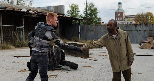 Morgan Jones (Lennie James) shakes hands with a mysterious stranger in a scene from season 6 of 'The Walking Dead'