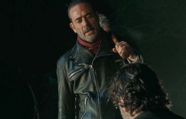 Negan (Jeffrey Dean Morgan) stands over Rick (Andrew Lincoln) in a scene from 'The Walking Dead's Season 6 finale.