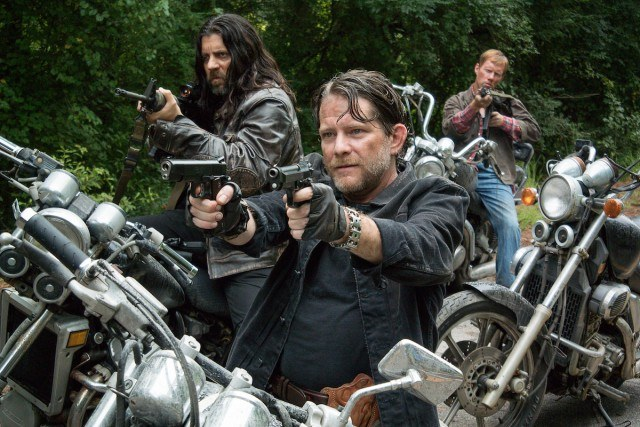 The Saviors point their guns in a scene from 'The Walking Dead's sixth season.