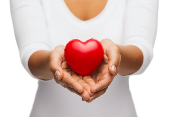 hands showing red heart