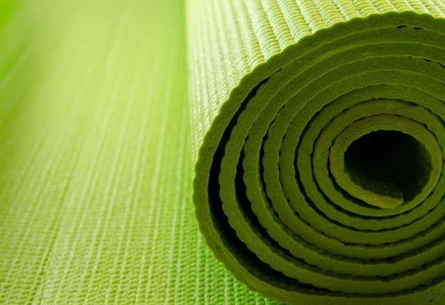 close-up of a partially rolled yoga mat
