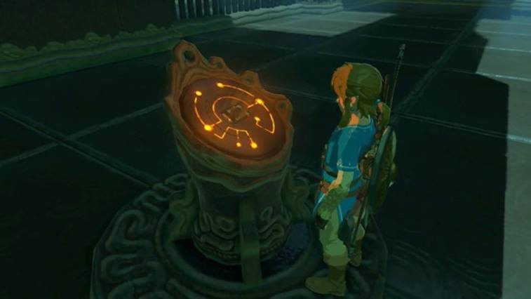 Link looks at a glowing stone in the new Zelda game.