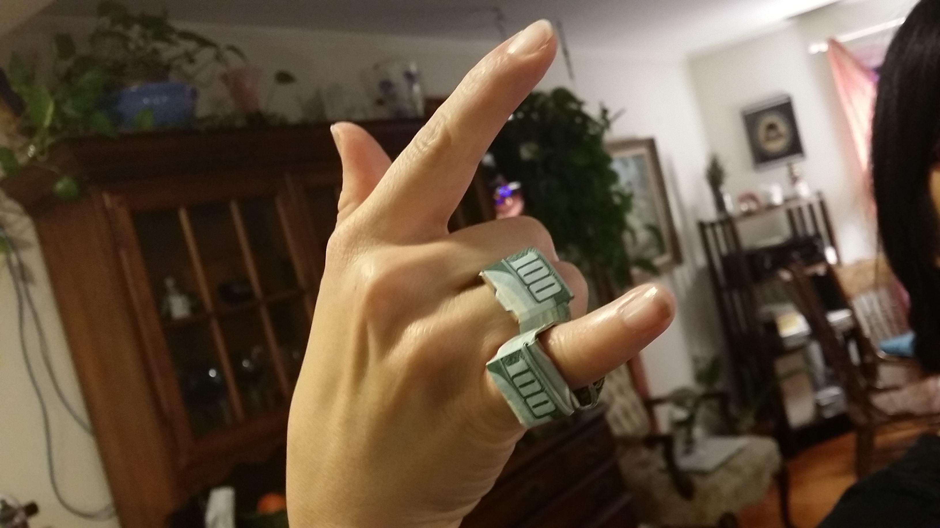 cash money on fingers