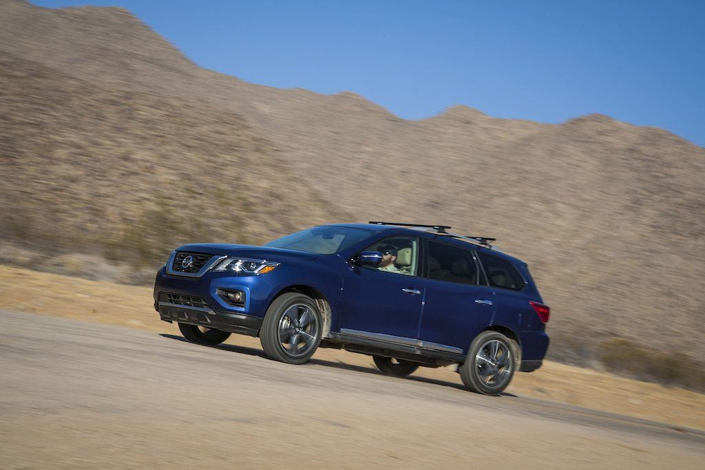 View of blue 2017 Nissan Pathfinder in front on mountainous terrain