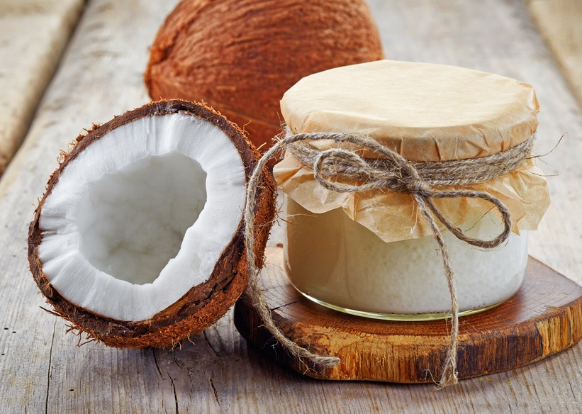 jar of coconut oil and fresh coconuts