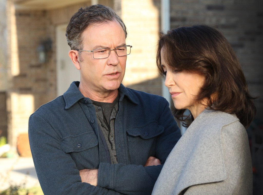 Felicity Huffman stands next to a man with glasses in American Crime