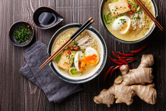 overhead image of two bowls of ramen noodle soup with eggs