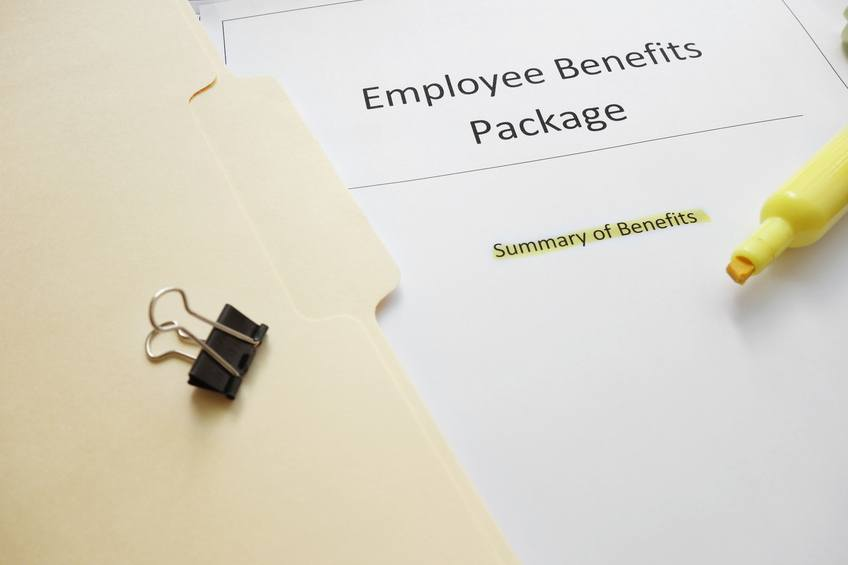 Employee benefits documents shown with a highlighter