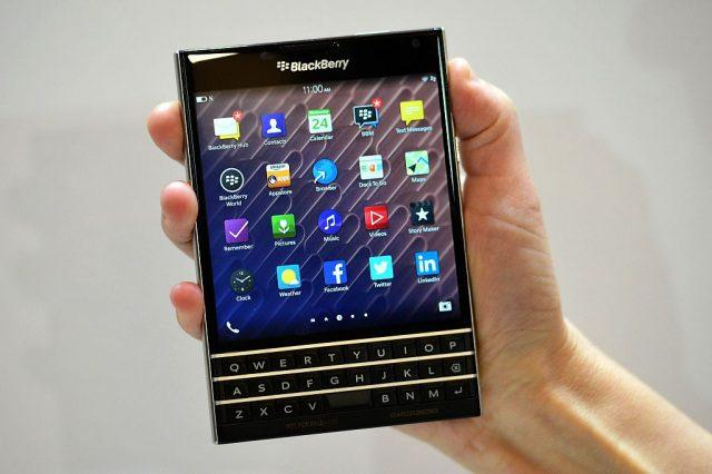 A woman holds the Blackberry Passport smartphone