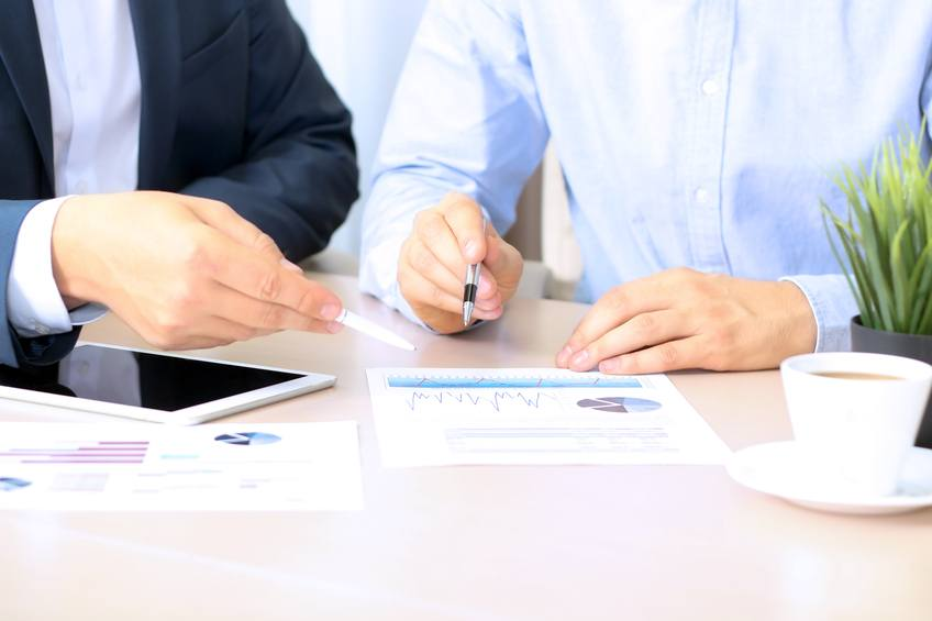 A financial adviser working with a client