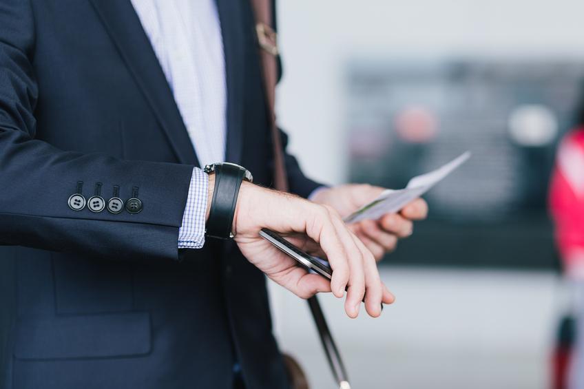 man checking time on wrist watch