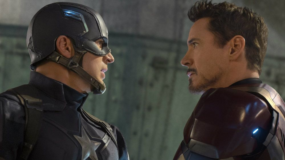 Chris Evans and Robert Downey Jr stare at each other in Captain America Civil War