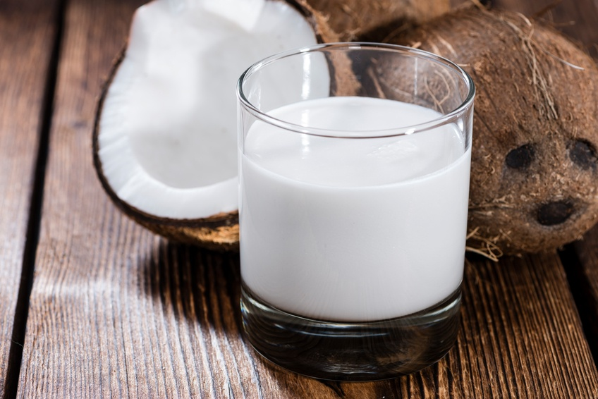 Coconut Milk in a glass with coconut