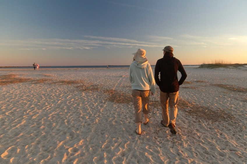 a couple walking on the beach in wrightsville north carolina