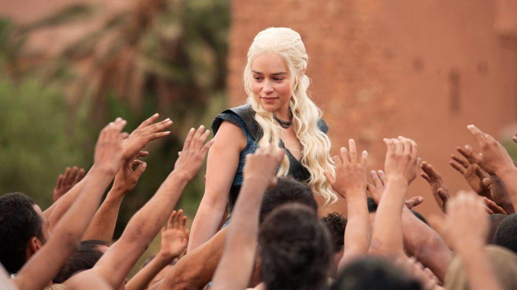 Daenerys with arms reaching up to her on Game of Thrones