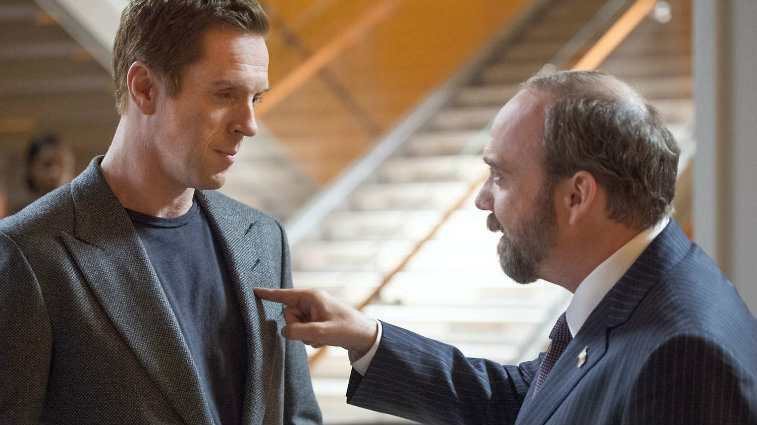 Damian Lewis and Paul Giamatti have a heated discussion in a scene from Billions