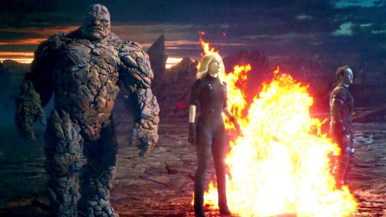 The Thing, Invisible Woman and Mr. Fantastic stand around a blazing fire in Fantastic Four