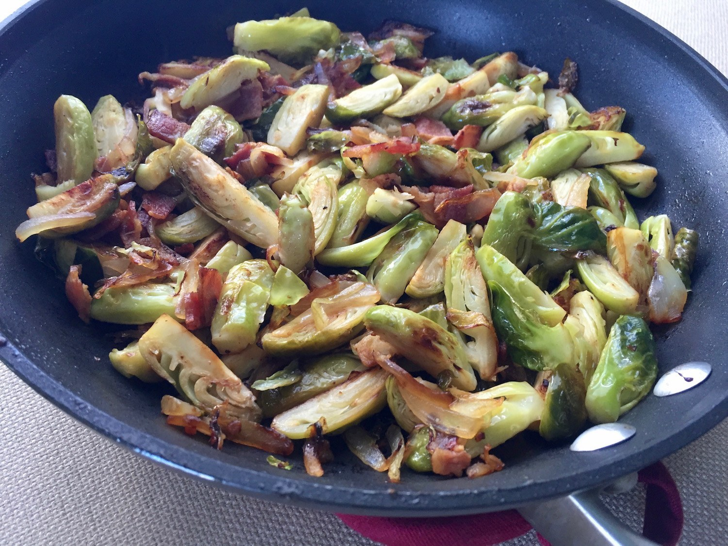 Brussels sprouts in a pan with onion and bacon