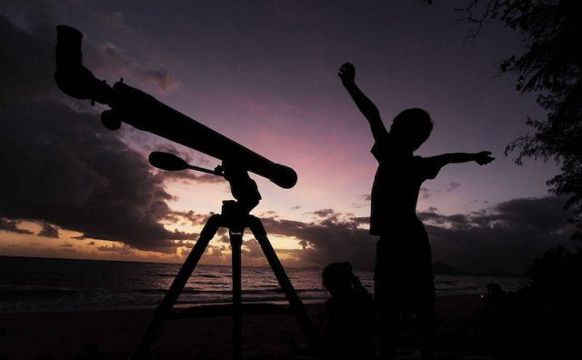 A young boy gets ready to view the solar eclipse with his telescope: Tech Products That Will Make Kids Want to Play Outside
