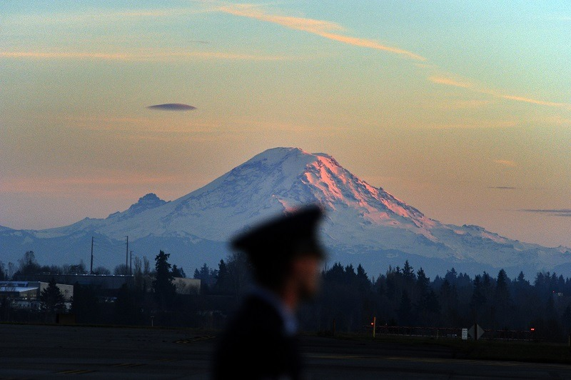 Air Force personnel man position as Mount Rainier looms near Tacoma, Washington