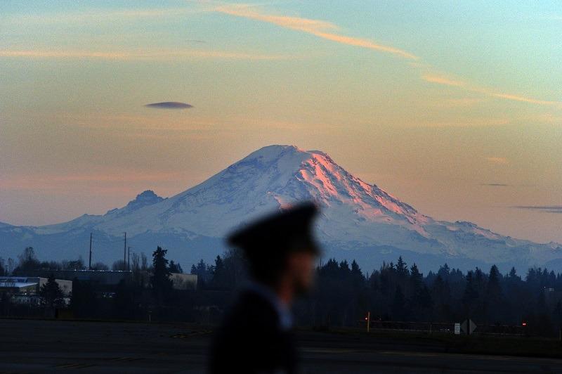 Air Force personnel man position as Mount Rainier looms near Tacoma, Washington